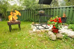 Backyard BBQ. Backyard garden BBQ outdoors preparation Royalty Free Stock Photos