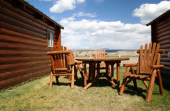 Backyard Cabin. Outdoor table and chairs between two cabins overlooking the mountains in the background Stock Images