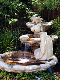 Backyard cascading fountain with statues Royalty Free Stock Photography
