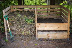 Backyard compost bins. Large cedar wood compost boxes with composted soil and yard waste for backyard composting Royalty Free Stock Images