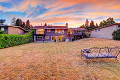 Backyard with cozy bench and fire pit overlooking scenic sky dur Royalty Free Stock Images