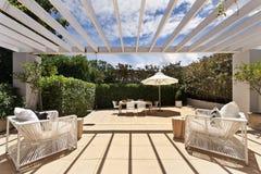 Backyard cozy patio area with wicker furniture set Stock Photos