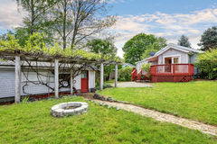 Backyard of craftsman home with red deck Stock Image