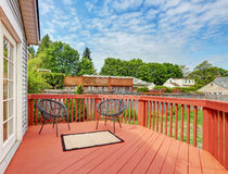 Backyard of craftsman home with red deck Royalty Free Stock Image