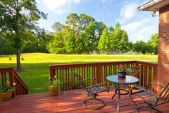 Backyard Deck. Residential backyard deck overlooking lawn and lake Royalty Free Stock Photo