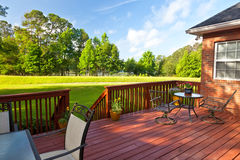 Backyard Deck. Residential backyard deck overlooking lawn and lake Royalty Free Stock Image