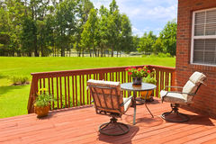 Backyard Deck. Residential backyard deck overlooking lawn and lake Royalty Free Stock Photos