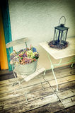 Backyard decoration with vintage lantern and flowers. Sweet home concept stock photo