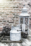 Backyard decoration with vintage milk can and lantern Stock Photos