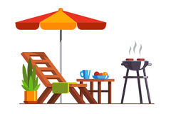 Backyard design with lounger and grill for bbq. Modern backyard design exterior with lounger, table, sunshade umbrella and electric grill for barbecue. Cooking Royalty Free Stock Photo