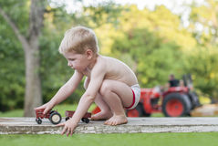 Child playing tractors outside Royalty Free Stock Photos