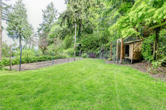 Backyard with fenced garden bed Stock Photos