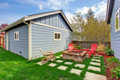 Backyard with fire pit and deck chairs Royalty Free Stock Photography
