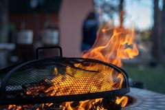 Backyard fire pit with grate royalty free stock images