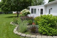 A backyard flower garden. Stock Images