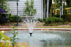 Backyard fountain Royalty Free Stock Image