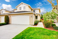 Backyard with garage and picturesque curb appeal Stock Image