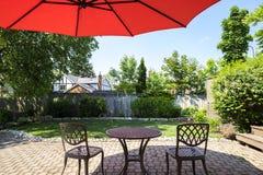 Backyard Garden with Bright Orange Cantilever Umbrella  1 Royalty Free Stock Photos