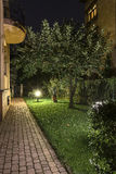 Backyard Garden Path at Night. Backyard Garden Path Brick with Lights at night with grass, trees stock photos