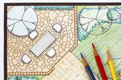 Backyard garden plan with stone patio Stock Photos
