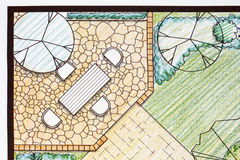 Backyard garden plan with stone patio Stock Images
