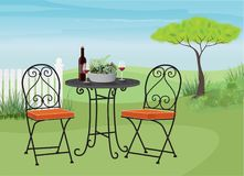 Backyard Garden Scene with Bistro Table Royalty Free Stock Images