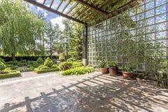 Backyard garden with shady pergola. And well-kept plants Royalty Free Stock Photo