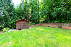 Backyard garden with wooden shed Royalty Free Stock Images