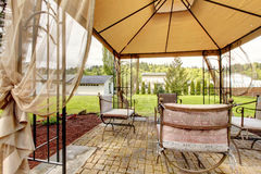 Backyard gazebo with antique chairs Royalty Free Stock Photo