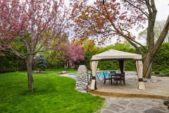 Backyard with gazebo and deck Stock Photo