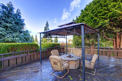 Backyard gazebo with patio set Royalty Free Stock Images