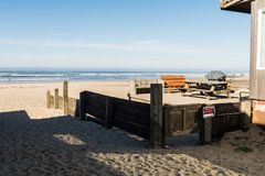 The backyard of a house in the same sand of Cannon Beach, Oregon, USA. stock images