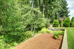 Backyard landscape design with greenbelt Royalty Free Stock Photography