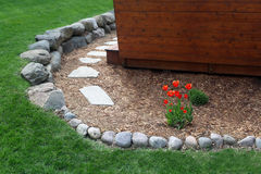 Backyard landscaping stone walkway. Backyard landscaping with stone walkway stock photos