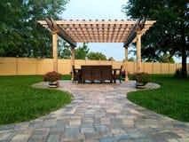 Backyard living. Pergola, easy living Stock Image