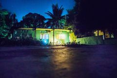 Backyard at night with house and lightened rooms, Bacalar, Mexico royalty free stock image