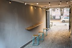 Backyard of old shabby building with one table cafe at the arc p. Assage. Wooden counter and chairs. Place for smoking and coffee Royalty Free Stock Image
