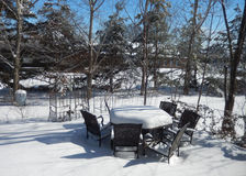 Backyard outdoor table and chairs in winter Royalty Free Stock Photo