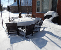 Backyard outdoor table and chairs in winter Royalty Free Stock Image