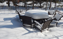 Backyard outdoor table and chairs in winter Royalty Free Stock Images