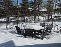Backyard outdoor table and chairs in winter Royalty Free Stock Photos