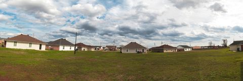 Backyard Panorama of low level stratus clouds moving over a urban community. With a railroad track stock photography