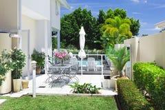 Backyard patio Stock Images