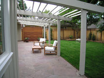 Backyard patio. View of lawn and patio in backyard Stock Images