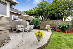 Backyard patio area and backyard landscape Royalty Free Stock Images