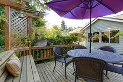 Backyard patio area with outdoor wicker furniture Stock Photos