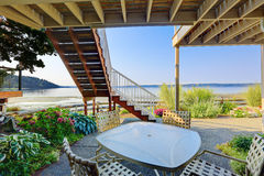 Backyard patio area with Puget Sound view, Burien, WA. Backyard patio area with table and chairs and scenic Puget Sound view, Burien, WA royalty free stock images