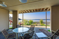 Backyard patio area with Puget Sound view, Burien, WA. Backyard patio area with table and chairs and scenic Puget Sound view, Burien, WA royalty free stock photo