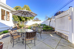 Backyard patio area with small garden Royalty Free Stock Image