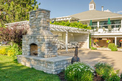Backyard Patio with Fireplace. Nice Backyard Patio with Gazebo and Big Brick Fireplace Stock Photo